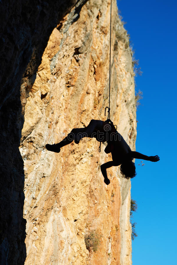 Climber hanging on rope stock image