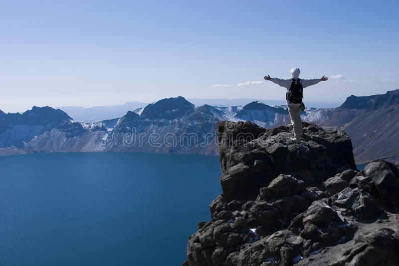 Climber and lake royalty free stock image