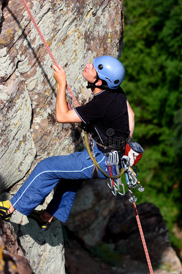 A climber rappelling royalty free stock image
