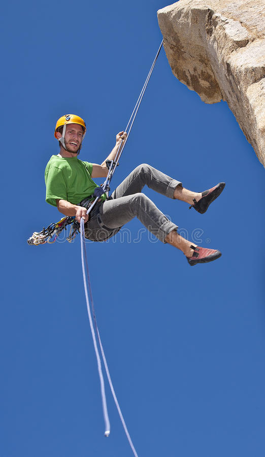 Climber rappelling from the summit. royalty free stock photo