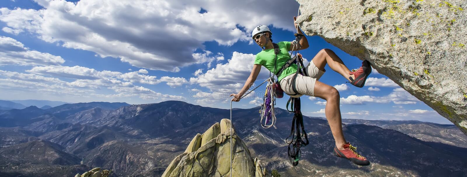 Climber rappels. royalty free stock image