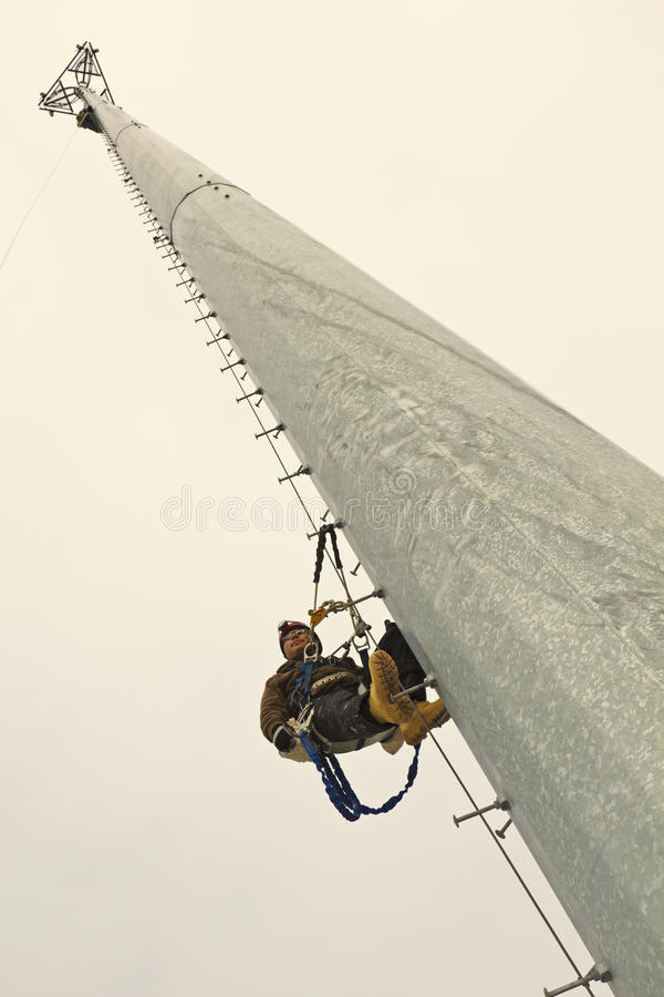 Climber resting in the middle of the climb royalty free stock images