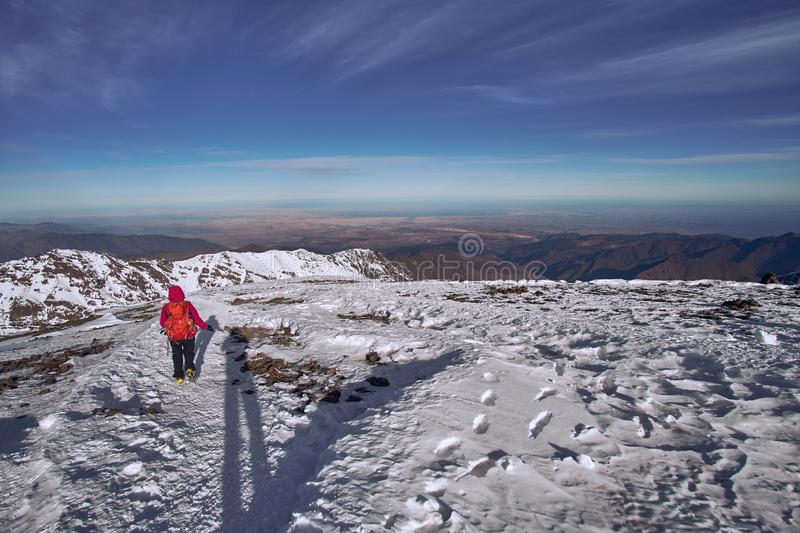 Climber returning from the top of Jebel Toubkal mountain royalty free stock photo