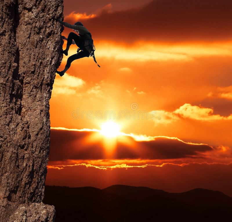 Climber on sanset royalty free stock photography