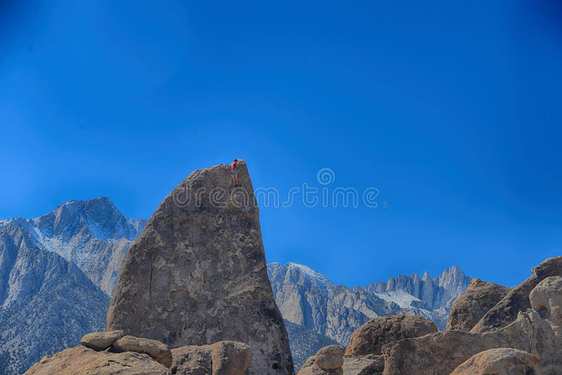 Climber on sharks fin arete route with mount whitney. In back ground at alabama hills , california royalty free stock image