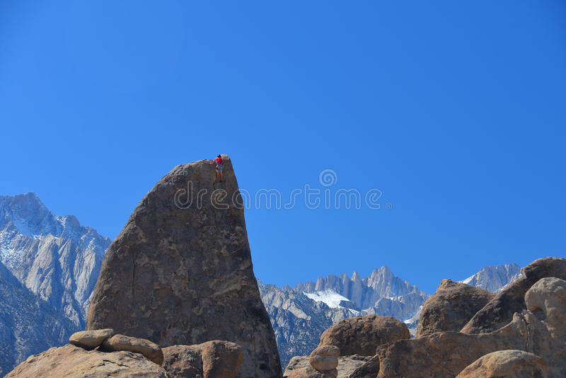 Climber on sharks fin arete route with mount whitney. In back ground at alabama hills , california royalty free stock photography