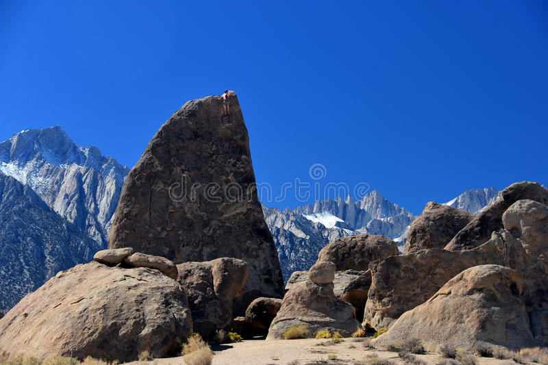 Climber on sharks fin arete route with mount whitney. In background at alabama hills , california stock image