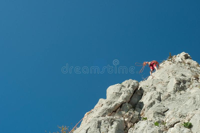 Climber in the sky. Climbing on a sunny summer day royalty free stock photo