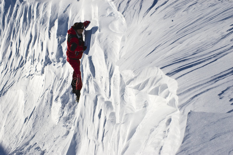 Climber in the snow stock image