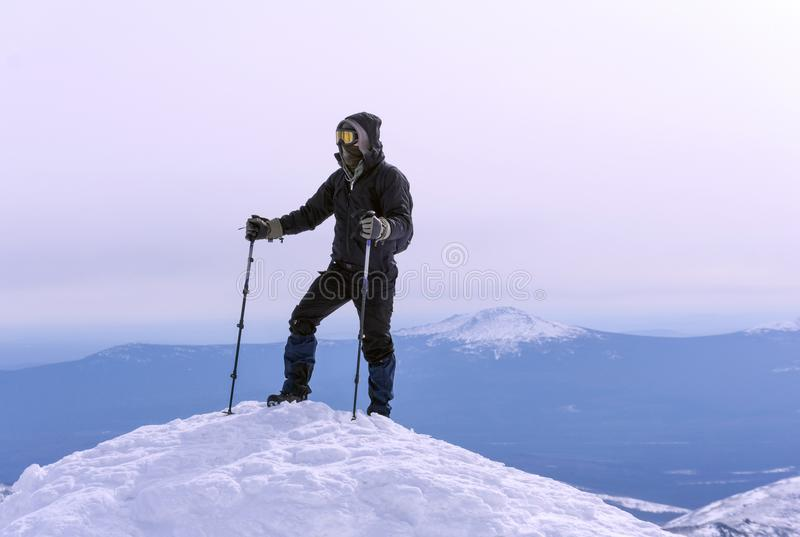 Climber on a snowy mountain top stock images