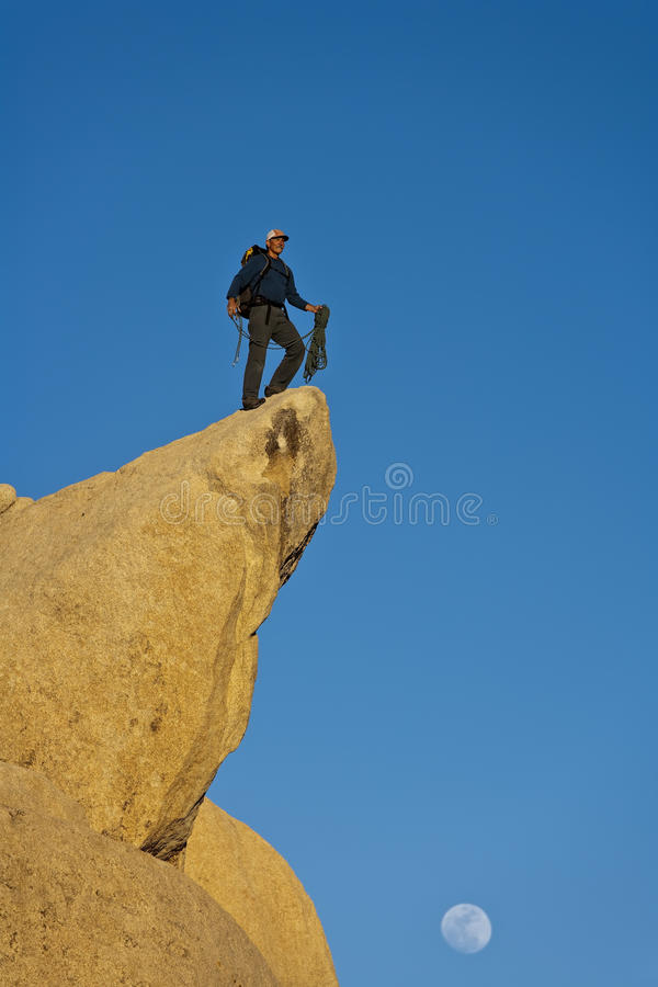 Climber on the summit. Climber on the summit of a rock spire after a successful ascent, in the Sierra Nevada Mountains, California stock photos