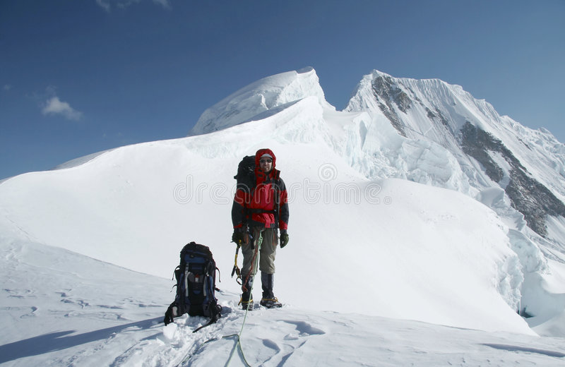 Climber on the summit stock photo
