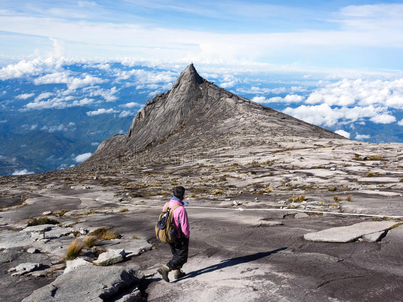 Climber at the top of Mount Kinabalu in Sabah, Malaysia royalty free stock photo