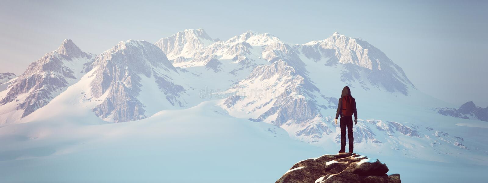 Climber on top of a mountain royalty free stock photos
