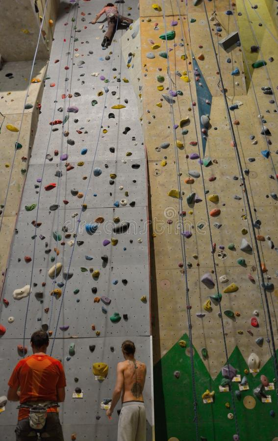 Climbers in action, Almost reaching the top. MORTSEL, BELGIUM, 6 OCTOBER 2014: Climber in action,Climbers in action, Almost reaching the top , indoor climbing stock images