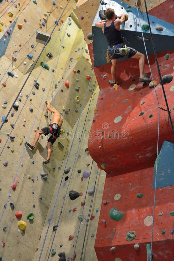 Climbers in action, Almost reaching the top. MORTSEL, BELGIUM, 6 OCTOBER 2014: Climber in action,Climbers in action, Almost reaching the top , indoor climbing royalty free stock image