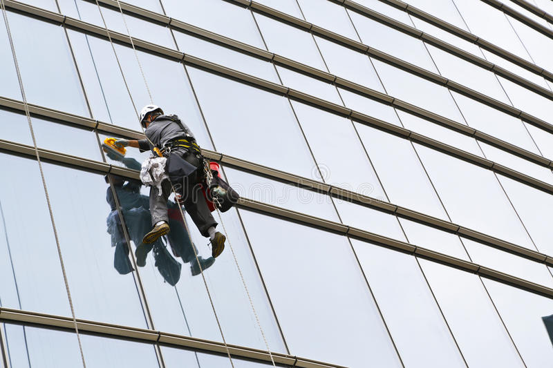 Climbers 3. Climbers on clean glass skyscraper stock image