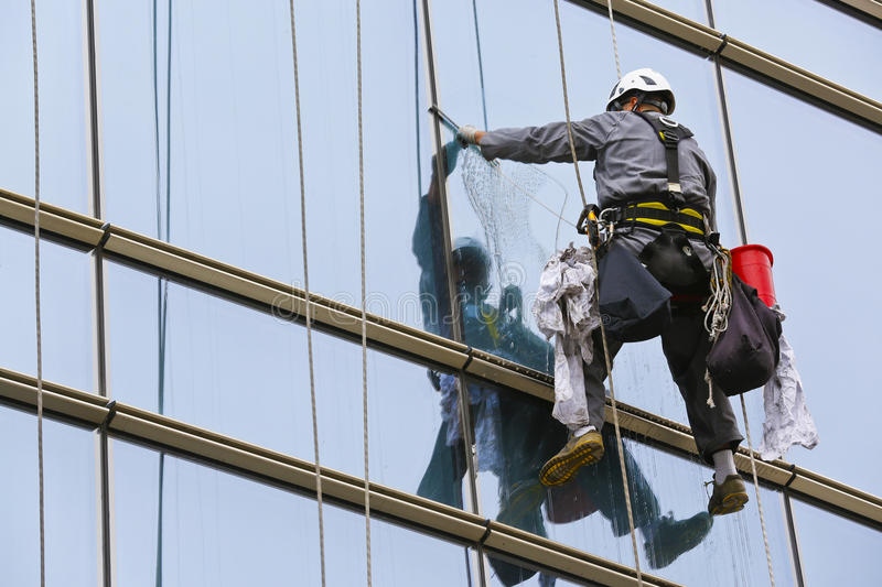Climbers 4. Climbers on clean glass skyscraper royalty free stock photos