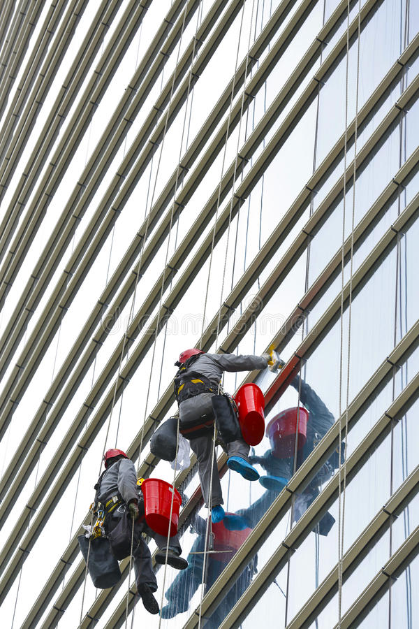 Climbers 5. Climbers on clean glass skyscraper royalty free stock images
