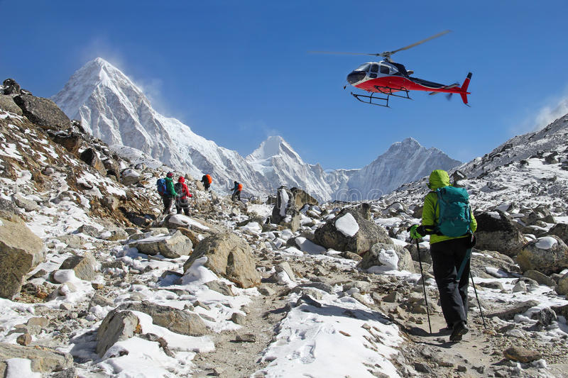 Climbers on the Himalayas peak stock images
