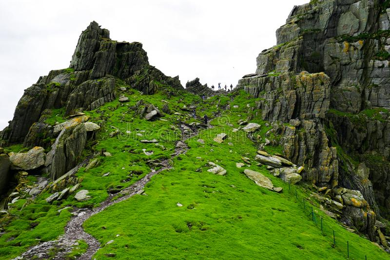Wild Atlantic Way: Breathtaking panoramic view framed by massive rugged pinnacles above `Christ`s Valley,` on Skellig Michael. stock images