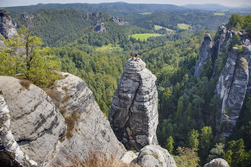 Climbers on sandstone rock in saxony sandstone mountains stock photography