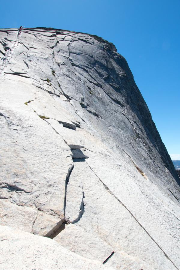 Climbers using cables to ascend Half Dome in Yosemite National Park in California USA royalty free stock photography