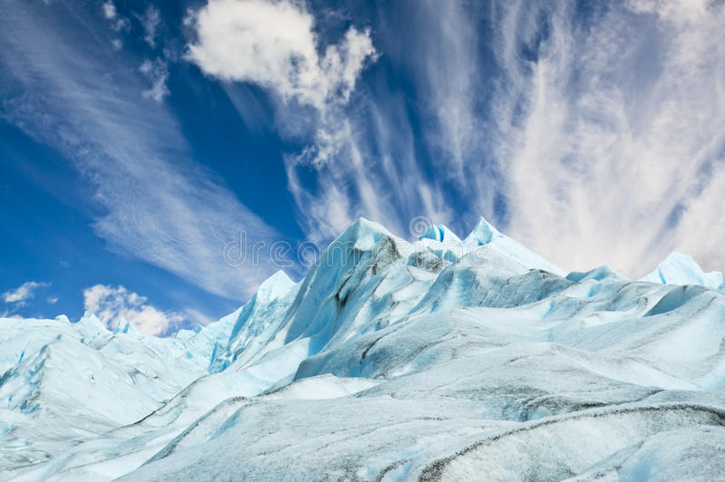 Climbers walk up on glacier in Patagonia. stock photography