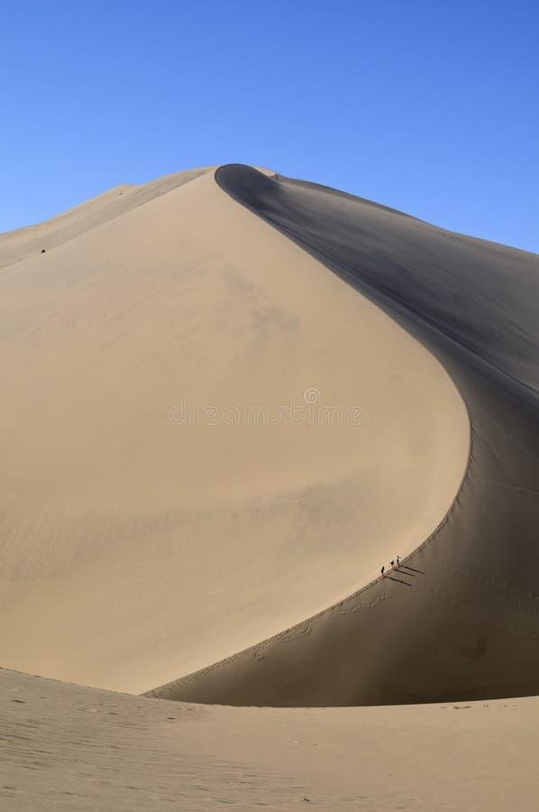 Free Climbing A Sand Dune. China Stock Photography - 14221232