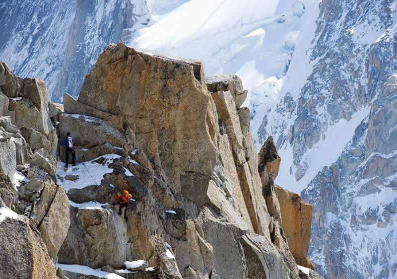 Climbing alpinists in Swiss Alps
