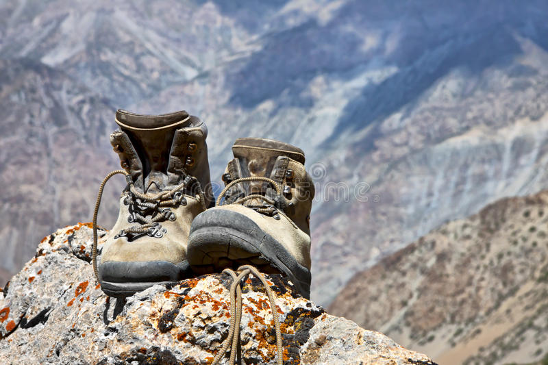 Climbing boots on the rock royalty free stock photos