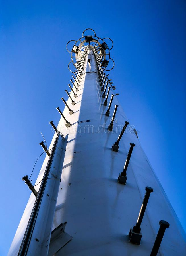 The climbing bracket of the telecommunication tower is very rhythmic. The perspective of the pole is very strong stock photos