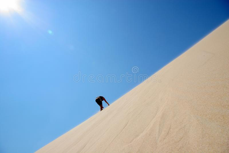 Climbing the dune royalty free stock image