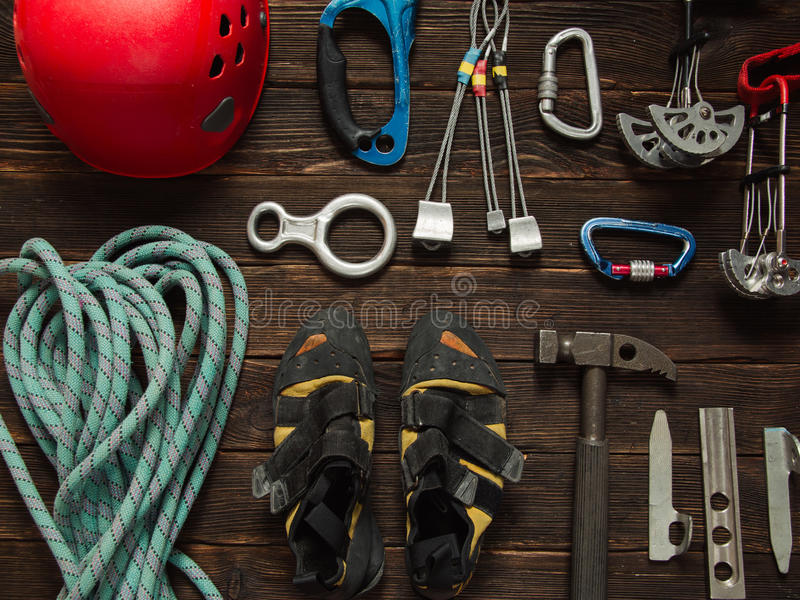 Climbing equipment on dark wooden background, top view stock photo