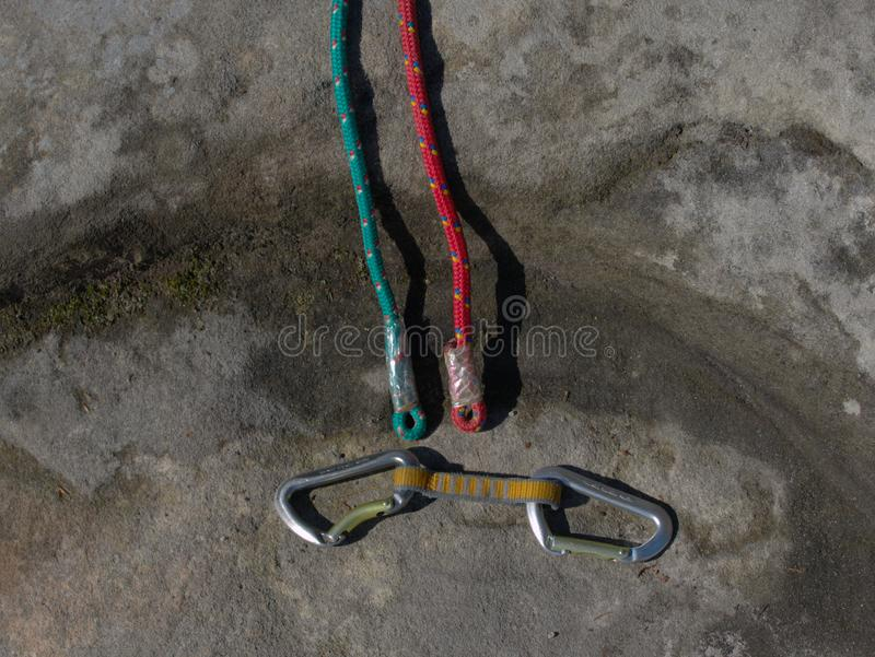 Climbing equipment - detail carabiners and rope stock photos