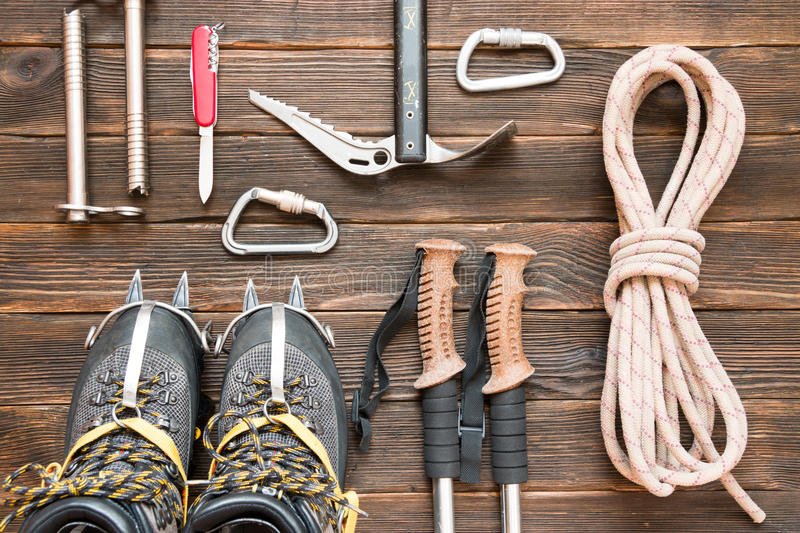 Climbing equipment: rope, trekking shoes, crampons, ice tools, i royalty free stock photography