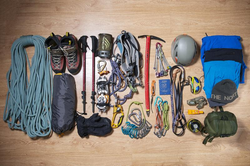Climbing equipment on a wooden background royalty free stock photos