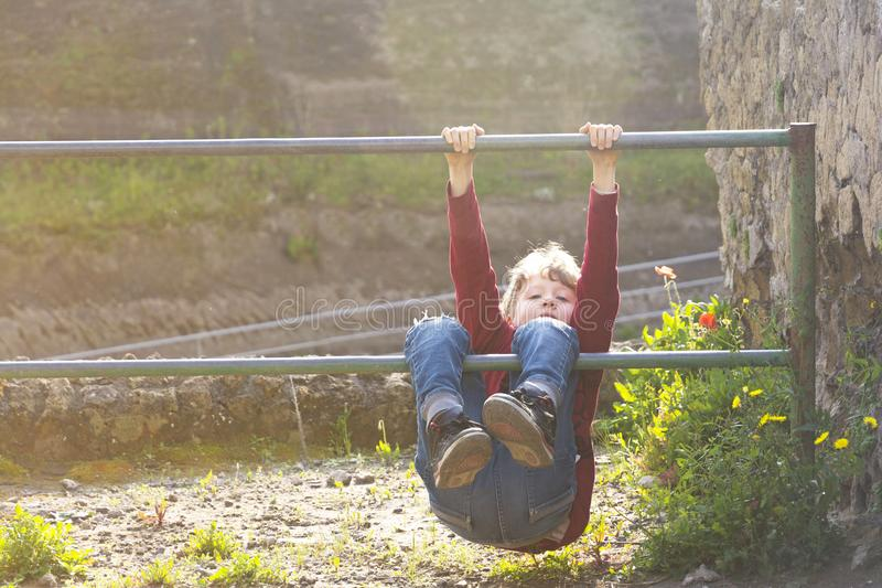 Child climbing fence stock image. Image of over, clever ...
