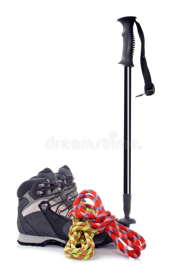 Climbing gear. A hiking pole, pair of boots and two ropes reflected on white background royalty free stock photography