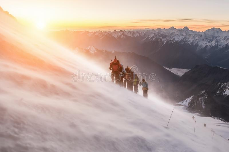 Climbing a group of climbers on Elbrus royalty free stock photography