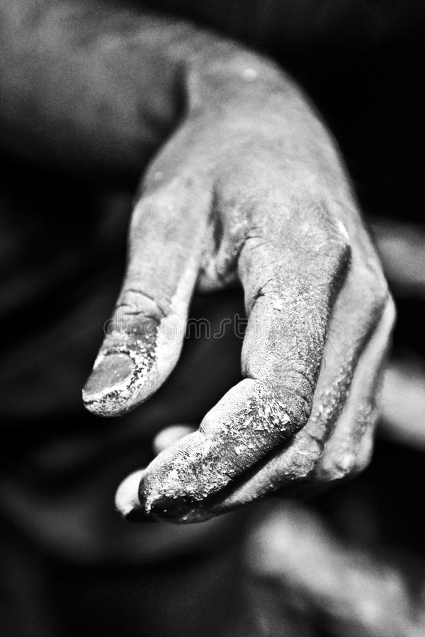 Climbing hand in magnesium, black and white.  stock photography