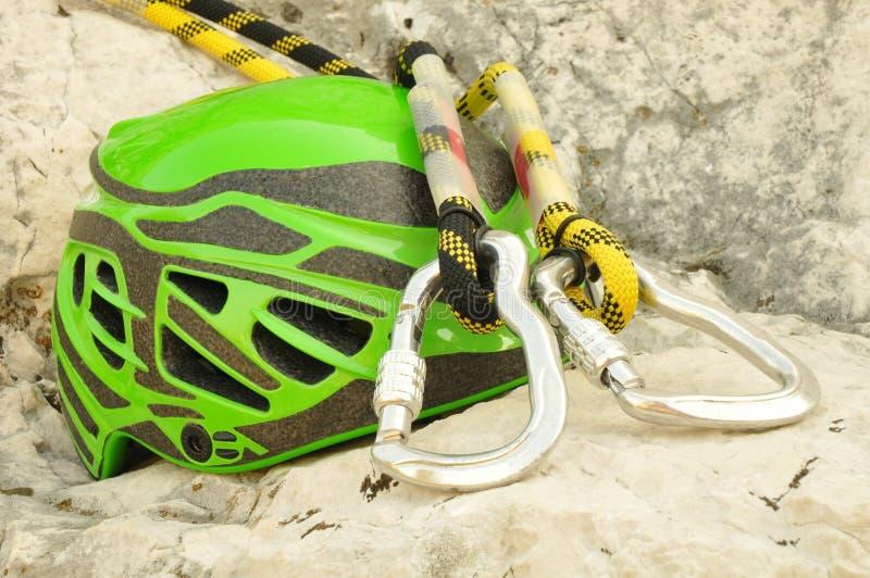 Climbing helmet and carabiners stock image