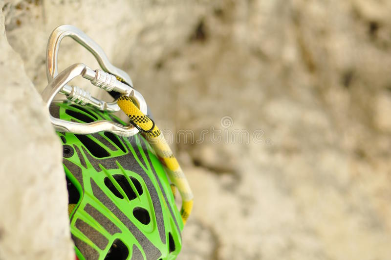Climbing helmet and carabiners royalty free stock photography