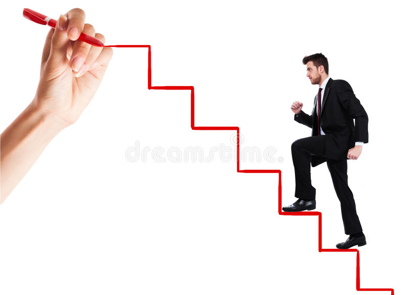 Climbing the ladder of success. Young man climbs the ladder of success royalty free stock photography