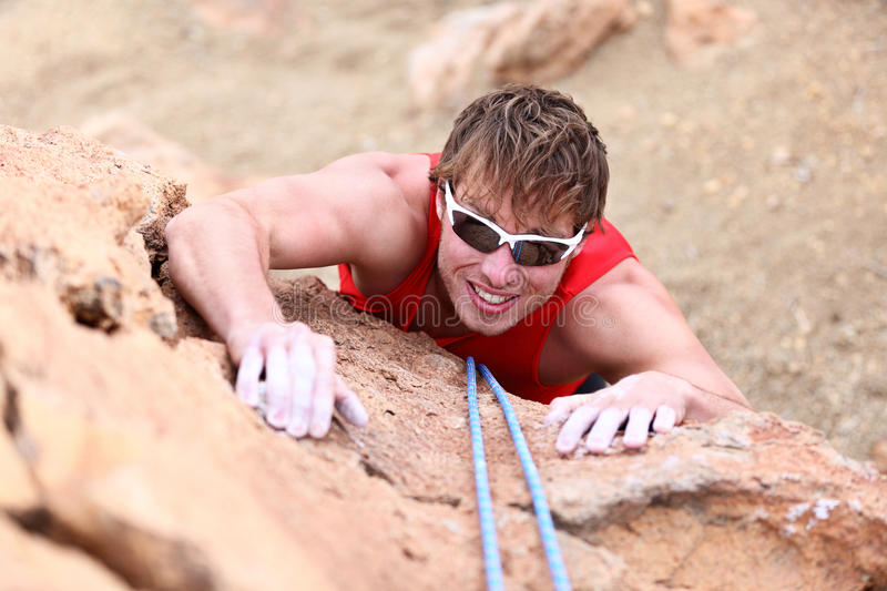 Climbing - male climber stock images
