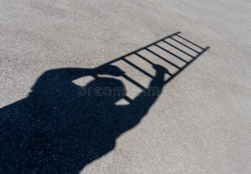 Climbing man shadow stock images