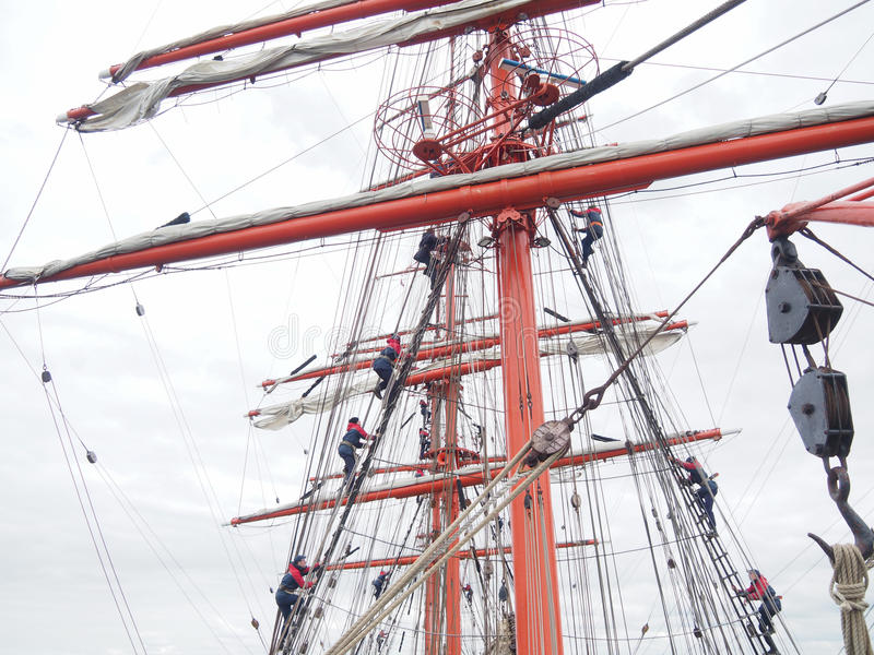 Climbing the mast on old tallship or sailboat stock image