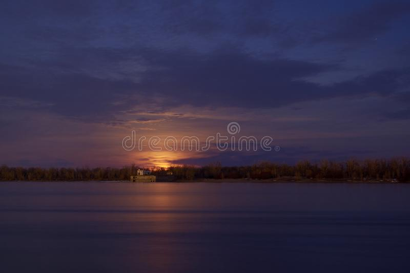 Climbing the moon by the river. royalty free stock image