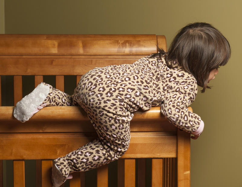 Climbing Out Of The Crib Stock Image