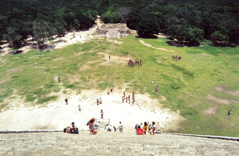 Climbing the pyramid at Chitchen Itza, Yucatan, Mexico royalty free stock images